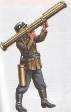 Fliegerfaust. German infantry anti-aircraft shoulder fired weapon along the lines of the Panzerschreck. The extra loads are set in a cicular magazine, like a speed loader  for a revolver. The tube hanging on the infantryman's shoulder holds the rocket reloads.