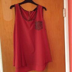 Leopard print reddish/Burgundy tank top Only worn once; runs true to size; color is in-between red and burgundy; runs a size smaller; ❌no damage Tops Tank Tops