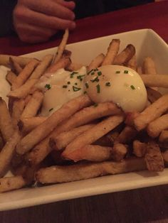 Duck fat fries with 2 poached eggs