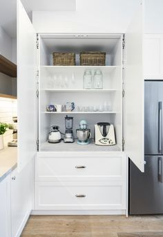 A dated kitchen is transformed into a beloved Hamptons haven with dark blue and white kitchen island, white cabinetry and timber floors. #hamptons #hamptonstyle #hamptonskitchen #hamptonscupboards Hamptons Kitchen, The Hamptons, Renovation Budget, White Kitchen Island, House Inside, Window Styles, Timber Flooring, Exterior House Colors, Pool Designs