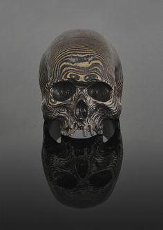 Mokumeganeskull - extraordinary skull ring by Joji Kojima. The skull has been hammered into the ground and become a cliche in the arts, but Joji has the magic.