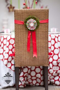 last minute dinner party decor - add a decorative wreath and ribbon to chair backs! How cute :)