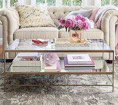 Interior Designer Inspiration for Styling Your Coffee Table Styling your coffee table sets the vibe for your entire living room. Image: Pottery Barn We hope you like the products we recommend. Coffee Table Styling, Decorating Coffee Tables, Coffee Table Design, Glass Top Coffee Table, Glass Tables, Coffee And End Tables, Round Coffee Table, Coffee Table Books, Coffee Table With Storage