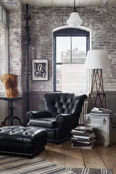 Inspired by a vintage motorcycle jacket, distressed black leather lends a laid back vibe to the iconic Writer's Chair. Apartment Interior, Home Interior, Interior Decorating, Interior Design, Interior Home Decoration, Masculine Room, Masculine Interior, Brick Loft, Industrial House