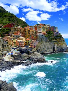 "ITALY - CINQUE TERRE  is a rugged portion of coast on the Italian Riviera. It is in the Liguria region of Italy, to the west of the city of La Spezia. ""The Five Lands"" is composed of five villages: Monterosso al Mare, Vernazza, Corniglia, Manarola, and Riomaggiore. The coastline, the five villages, and the surrounding hillsides are all part of the Cinque Terre National Park and is a UNESCO World Heritage Site."