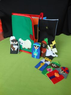 Set of 8 felt Christmas Finger Puppets with or without the story book.