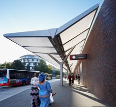 Railway station bus shelter Y-shaped columns with lighted canopy.