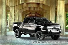 Lifted 2013 Chevy Silverado Black Widow by Southern Comfort