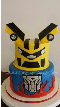 Transformers cake with Bumblebee and Optimus Prime  Www.facebook.com/simplycakes.brittneyshiley