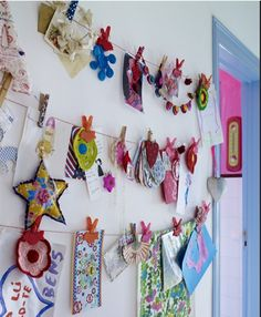 This is how I plan to display family pics interspersed with cards, etc. Need to find source for small colored bullnose clips. I like better than easier-to-find binder clips.