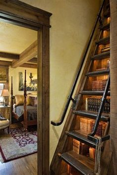 Books under the stairs.