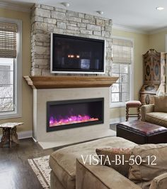 Sierra Flame Vista BI-50-12 electric #fireplace with stone wall, wood mantel, TV above.