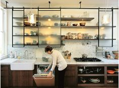 Alternatives to Kitchen Cabinets. don't see the point of the sliding glass doors though.