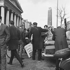 Ireland An Evening Press newspaper seller does a brisk trade on O'Connell Street, Dublin on the day after Nelson's Pillar was blown up. Photographer: Elinor Wiltshire Date: Wednesday, 9 March 1966 Ireland Pictures, Old Pictures, Old Photos, Dublin Street, Dublin City, Galway Ireland, Ireland Travel, Irish English, Iconic Photos