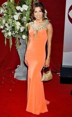The bag is so, so 90s but I love Eva Longoria in this Angel Sanchez dress