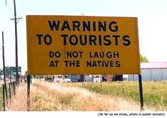 Funny traffic signs and funny warning sings: Warning to tourists! Do not laugh at the natives!