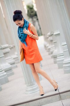 Love this color combo!  Just bought a pretty coral/orange dress and will probably accent it with a turquoise/blue statement necklace...