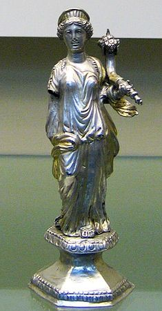 Fortuna: silver statuette with gilt traces. The crowned goddess holds a cornucopia in her left hand; her right arm is lost. Roman (probably made in Gaul) 200-225 CE. London, British Museum