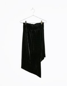 Asymmetric pleated velvet skirt. Discover this and many more items in Bershka with new products every week