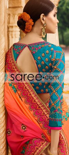 Contrasting hues put together to make a lovely designer sari! The blue and orange coloured half-and-half sari has colorful ethnic and floral patterns. A hint of pink on the pallu adds a further touch of liveliness to the vibrant drape. A blue silk blouse Sari Blouse Designs, Saree Blouse Patterns, Fancy Blouse Designs, Blouse Styles, Blue Silk Saree, White Saree, Orange Saree, Sari Bluse, Indie Mode