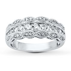 Classically designed with a feminine touch, this lovely 14K white gold filigree ring features round diamonds totaling 3/4 carat in weight. Diamond Total Carat Weight may range from .69 - .82 carats.