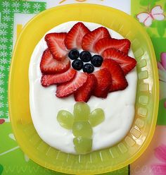 For a fun spin on breakfast, take a cue from Kiddie Foodies and top your child's yogurt with fresh fruit shaped into a flower.