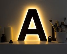 Letter light with warm white LEDs Creates cozy and relaxing atmospehere thanks to warm backlight. Made from plywood and finished in your choice of https://www.etsy.com/uk/listing/191956916/wooden-letter-lighted-a-decorative?ref=related-0