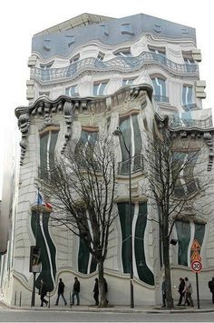 Although it looks like a distorted picture, this is a real building in Paris!