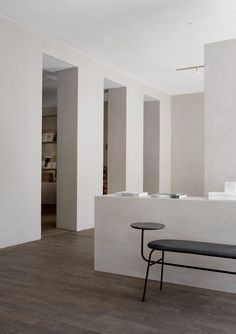 """Kinfolk's open-plan workspace is furnished with banks of bespoke oak tables, and has walls covered in sandy-toned plaster that give them a """"special earthy wabi-sabi quality"""". The plasterwork is intended to echo the facades of Copenhagen's neoclassical buildings."""
