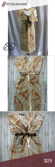 """Iridescent Silk Boho Chic Dress Size L Iridescent Silk Boho Chic Dress Size L  Condition:  NWOT Type: Dress Style: Tie Waist Size: L Color: Brown, Toffee,  Gold Features: Silk Shell, tie waist, iridescent stripes Measurement: 35"""" Chest, 32"""" Waist, 26"""" Length  Materials:  Shell- 82% Rayon, 18% Silk; Lining - 100% Polyester  Country of Manufacturer: N/A  Closet Note:  The design makes me think ancient sundial. We would wear the shell alone over a tank and jeans or shorts for a cute boho look…"""