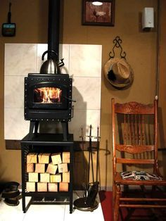 Marine wood-burning stove in this small kitchen. That copper back ...