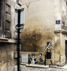 Street Art in Bordeaux, France| This really says something about society. Adults are so busy and lost in themselves, that they don't give a thought to helping someone in need. Children on the other hand still have there innocence to where they can see the good in people a will try to help. You shouldn't judge someone as a child, or an adult by there age, but the amount of innocence they contain.