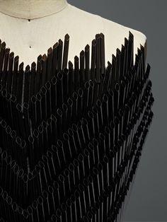 Gareth Pugh (British, born 1981) .Dress, autumn/winter 2015–16, Prêt–à–Porter. Machine–sewn black silk–wool gazar, hand–embroidered with black plastic drinking straws. Photo © Nicholas Alan Cope. #ManusxMachina #CostumeInstitute