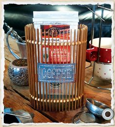 A caffeine inspired, coffee bean shaped, coffee holder made from coffee stained coffee shop stirring sticks.