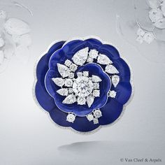 Van Cleef & Arpels Fleur de lapis-lazuli clip, Pierres de Caractère Variations collection  White gold, lapis lazuli, round and pear-shaped diamonds and one round D IF diamond of 3.05 carats.
