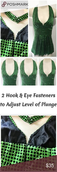 Nanette Lepore Pin-up Style Halter Top Beautiful green silk halter top, by Nanette Lepore and from Anthropologie, with navy blue polka dots. Features a built in elastic bra strap to give the bust area a push up effect and hold the girls firmly in place. The v-neck bust has two hook and bar fasteners to adjust the level of plunge and amount of cleavage shown. Labeled a Sz 4. Excellent pre-loved condition with no apparent wear. Anthropologie Tops Blouses