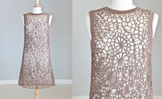 Original 1960's tape lace dress. A brilliant foundation for a formal set. We imagine a silk underdress peeping through the lace.