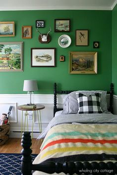 Love everything about this room, the gallery wall, the green, the adorable bedding