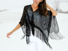 I know it's not a t-shirt, but still a great way to recon something in a clever way! Trash To Couture: DIY fringe poncho