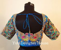 Peacock themed bridal blouse by YUTI! Beautiful peacock blue color designer blouse with pair of peacock design hand embroidery thread and bead work. For Price and Other details reach at or Whatsapp: Peacock Blouse Designs, Peacock Embroidery Designs, Latest Embroidery Designs, Kids Blouse Designs, Wedding Saree Blouse Designs, Pattu Saree Blouse Designs, Blouse Neck Designs, Blouse Styles, Peacock Design