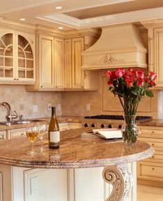Stunning craftsmanship throughout.  Look at all the detail in the cabinets and island.  I love this kitchen design (it's nice and bright too).