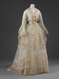 The dress is of cream silk gauze with narrow opaque stripe, and trimmed with cream silk embroidered net lace. l Victoria and Albert Museum #weddings