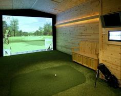 This man cave found in Hopkins, MN is equipped with a golf simulator large enough to invite your friends over for a game...I would have darker wood on the walls.