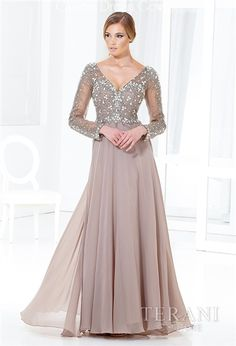 Terani Couture M3811 is a Crystal Encrusted Chiffon A-Line Gown with an Elegant Wide V-Neckline, Crystal Beaded Illusion Long Sleeves and Fitted Bodice Over Sweetheart Interior Bodice, Chiffon A-Line Floor Length Skirt, Illusion Crystal Beaded V-Back