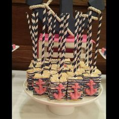 Nautical Rice Krispie Pops With Pink Anchors.....  Follow my page on Instagram: SugarSweetOlivia