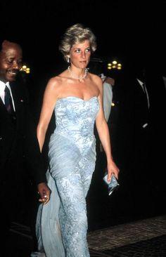 Princess Diana: The Princess of Wales arrives at a presidential banquet held in Douala, Cameroon, March 1990. She wears a Catherine Walker dress. (Photo by Jayne Fincher/Princess Diana Archive/Getty Images)