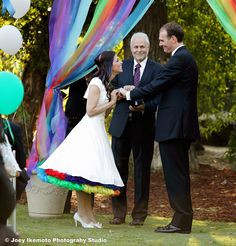 Short wedding dress with rainbow petticoats.aw theres something about this that i love, love the colors!!!!