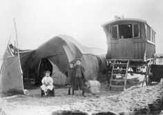 Gypsy children with bender tent and vardo at South Shore, Blackpool
