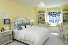 I love yellow and blue together, but I pinned because of the bed side lamps.   Not matching, but both coordinate with the room