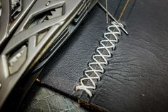 How to hand-stitch two pieces of leather using a cross stitch.